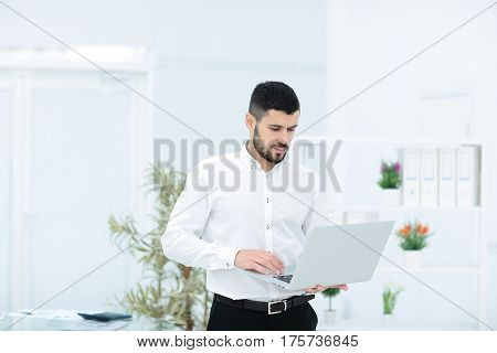 Portrait of a young businesswoman in modern office
