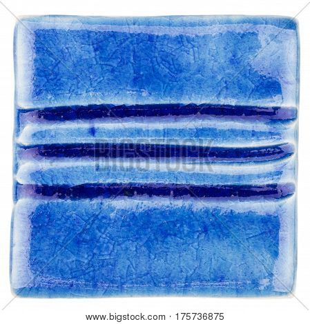 Blue lined handmade glazed ceramic tile isolated on white background