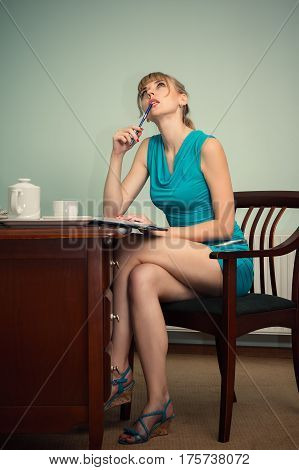 pensive charming woman sitting at the table