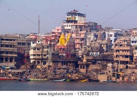the view from the boat to the shore of the sacred river Ganges in Varanasi. Holiday