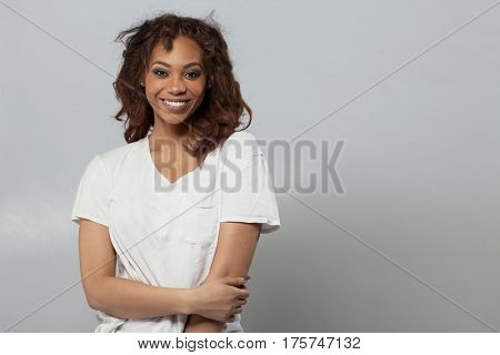 Happy beautiful African American woman with curly hair.