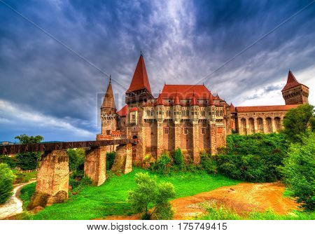 Beautiful Hunyad Corvin medieval castle in the sunset light after storm Hunedoara townTransylvania regiomRomaniaEurope