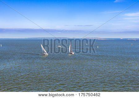Sailing regatta in Bay of West Harbour. Sailing ship yacht with white sails involved in water sports. Marine navigation in sunny summer day. Suomi Helsingfors Helsinki Finland