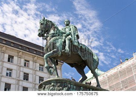 Statue of bronze horseman over blue sky