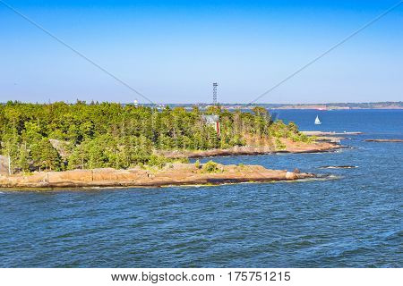 Stone beach with places for sunbathing swimming and relaxing on a rocky island in Pihlajasaari Recreational Park. Scandinavian islands architecture in Helsinki Finnish Gulf Finland Suomi