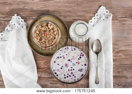 Cereal set on wooden table, view from above.