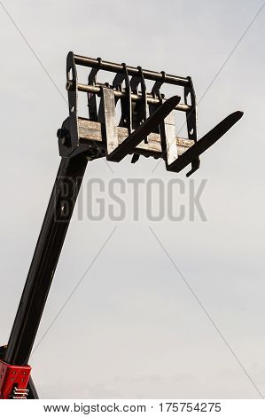 Bucket Lift With Blue Sky In Background