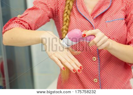 Woman Holding Facial Cleansing Brush