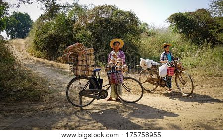 People On Rural Road In Bagan, Myanmar