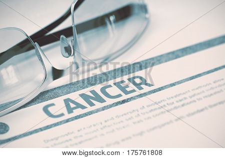 Cancer - Medicine Concept with Blurred Text and Spectacles on Blue Background. Selective Focus. Cancer - Medical Concept on Blue Background with Blurred Text and Composition of Specs. 3D Rendering.