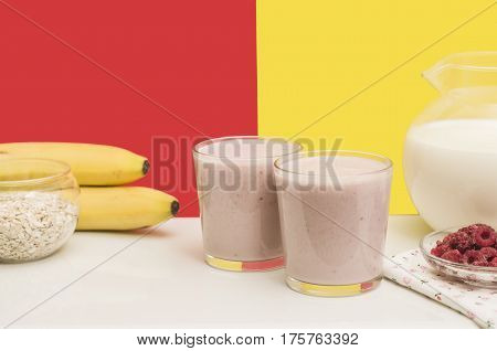 Useful banana smoothie with oatmeal and raspberry berries. Bright and healthy breakfast