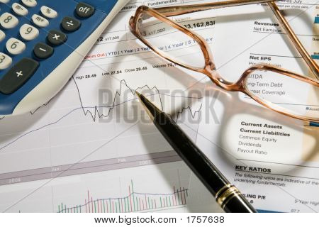 Pen Over Business Or Stock Report