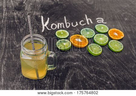 Homemade Fermented Raw Kombucha Tea Ready To Drink With Orange And Lime. Summer
