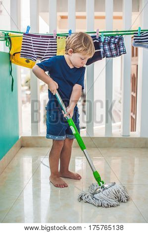 Kid Boy Cleaning Room, Washing Floor With Mop. Little Home Helper. Montessori Concept