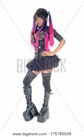 A beautiful African American steampunk woman in a corset and spike bra standing in short skirt and long boots isolated for white background.