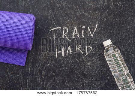 Sports Motivational Text. Train Hard On A Chalk Board