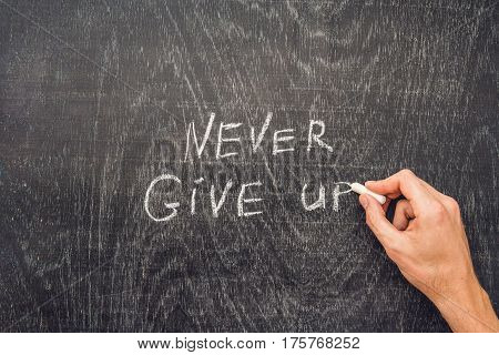 Never Give Up Words Written On The Chalkboard