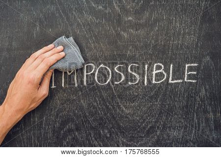 Making The Impossible Possible Concept On Blackboard Background