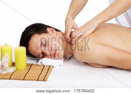 Masseuse makes a relaxing back massage to a man