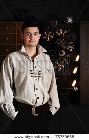 Beautiful man in the interior in the style of steampunk