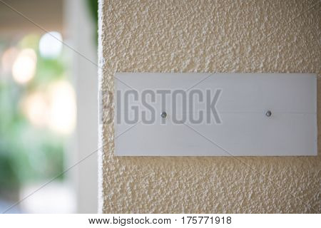 grey plaque on the wall. place for text