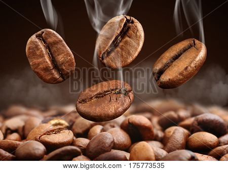Macro falling coffee bean with steam on brown background
