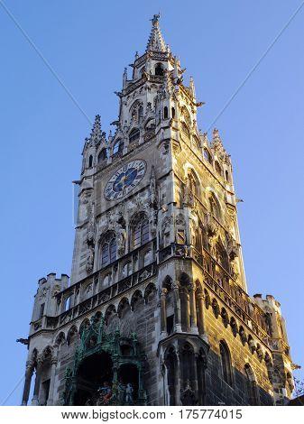 Munich Germany - July 2015: Marienplatz clock tower in golden morning sunlight