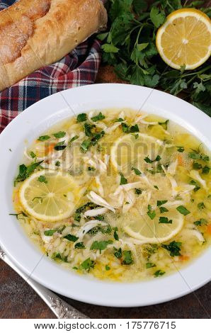 Avgolemono greek chicken soup with egg-lemon sauce orzo and fresh parsley leaves