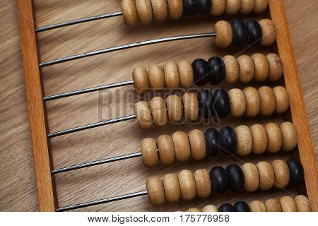 Vintage wooden abacus on the table, Antiques