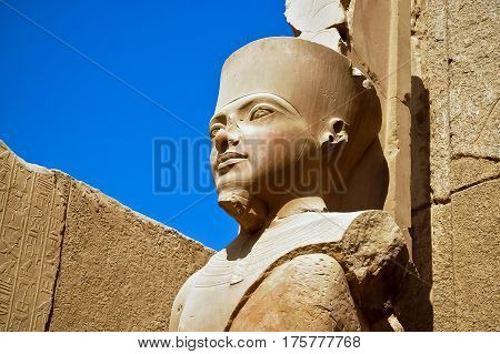 A statue of Amun Re in the Temple of Amun in Karnak, Luxor, Egypt.