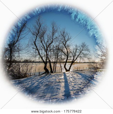 Noon on the frozen river in winter. Styling in icy frame.