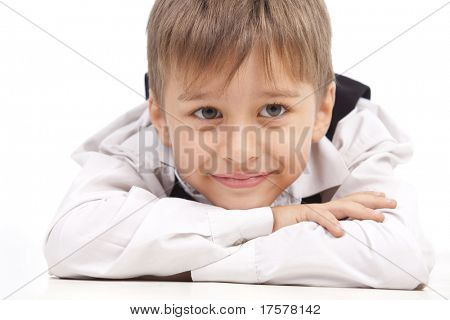Kid looking at something - laying flat on the floor