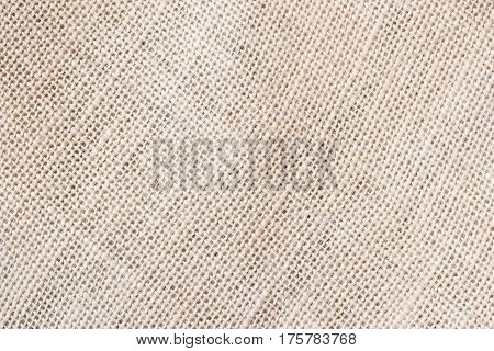 Sackcloth or burlap background with visible texture copy space for text and other web print design elements. Closeup of light natural sackcloth, canvas, fabric, jute, texture pattern for backdrop