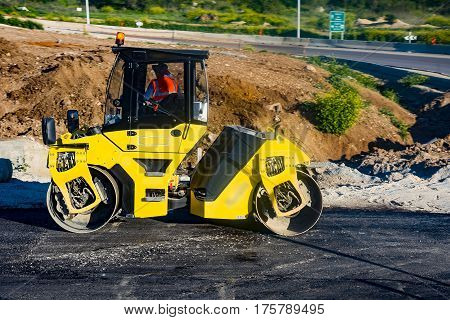 Heavy Vibration roller at asphalt pavement works Asphalt paver road repair Asphalt paver road repair