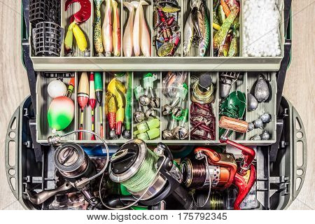 many different fishing tackle gear  in box