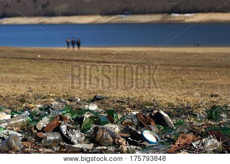 Plastic Glass  Metal And Paper Waste On The Lakeside