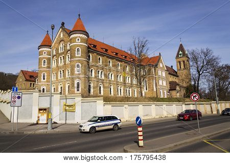Prague, Czech Republic - March 3: Cars In Front Of Cloister For Sale And The Annunciantion Church Of