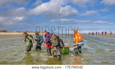 ROTTUMERPLAAT NETHERLANDS - MARCH 6: Soil investigation expedition crossing tidal channel on Rottumerplaat Island protected nature reserve on march 6 2016