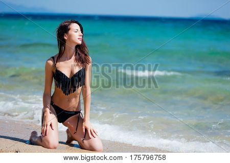 Beautiful Young Woman Standing On Her Knees On Wonderful Sand Beach In Greece