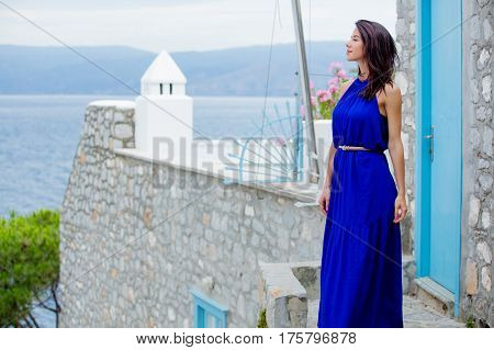 Photo Of Beautiful Young Woman Standing On The Stairs Near The House In Greece