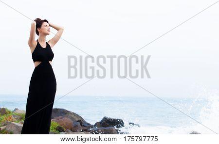 Beautiful Young Woman Standing On The Stone Coast In Sunny Sri Lanka
