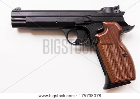 Pistol on a white background. Handle right.