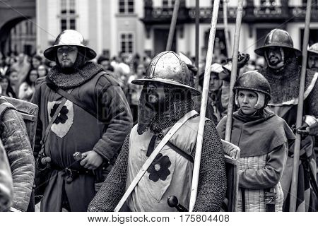 PRAGUE CZECH REPUBLIC - SEPTEMBER 04 2016: Armored knights lead the march of Charles IV at re-enactment of the Coronation of Charles IV in Prague Castle.