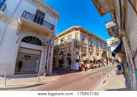 LIMASSOL CYPRUS - MARCH 18 2016: Street with lace and tablecloth shop in the historic center of Limassol city.