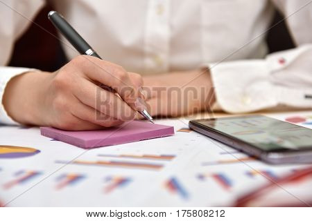 Accountant Writes Data Of Business Report