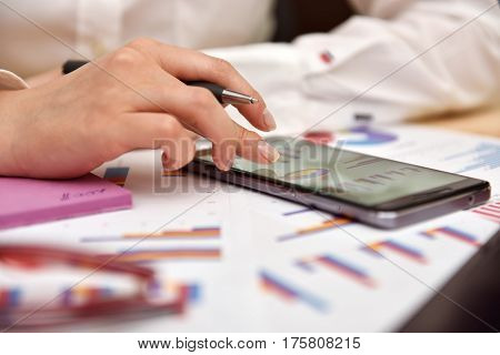 Phone With Data Of Business Report