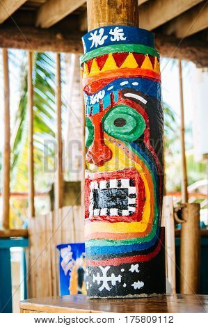 Totem pillar painted on the wood in tropical island