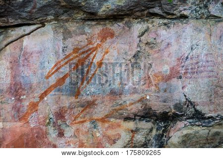 Aboriginal paintings on rock, Kakadu National Park, Northern Territory, Australia. The painting is a warning not to disturb a sacred site and threatens swollen joints