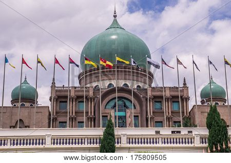 View of Putra Palace, Prime Minister's Office in Putrajaya, Malaysia with Malaysian state flags