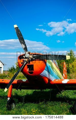 Colorfull Airpane Parked On The Grass At The Airfield
